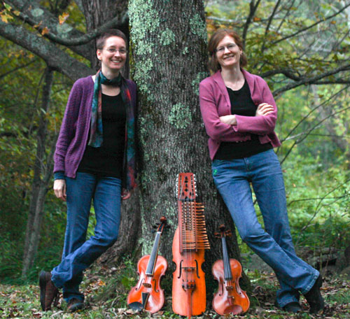 lydia and Andrea with instruments and tree
